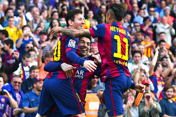 BARCELONA, SPAIN - APRIL 18:  Luis Suarez (C) of FC Barcelona celebrates with his teammates Lionel Messi (L) and Neymar of FC Barcelona after scoring the opening goal during the La Liga match between FC Barcelona and Valencia CF at Camp Nou on April 18, 2015 in Barcelona, Spain.  (Photo by David Ramos/Getty Images)