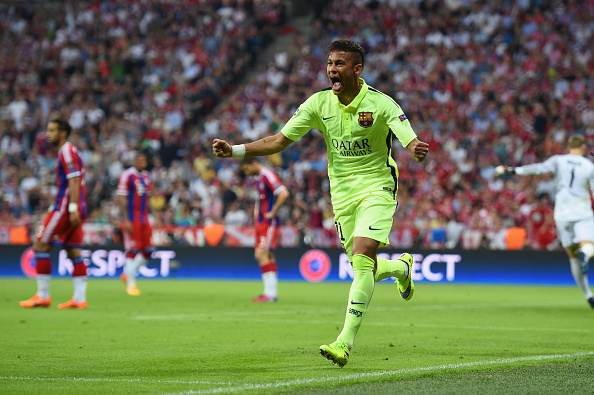 MUNICH, GERMANY - MAY 12:  Neymar of Barcelona celebrates as he scores their first goal during the UEFA Champions League semi final second leg match between FC Bayern Muenchen and FC Barcelona at Allianz Arena on May 12, 2015 in Munich, Germany.  (Photo by Matthias Hangst/Bongarts/Getty Images)