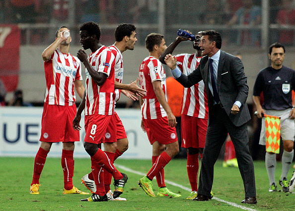 ATHENS, GREECE - SEPTEMBER 16:   Olympiacos players celebrate a goal  during the UEFA Champions League Group A match  between Olympiakos and Atletico Madrid at Georgios Karaiskakis Stadium on September 16,2014 in  Piraeus, Athens, Greece.   (Photo by Milos Bicanski/Getty Images)