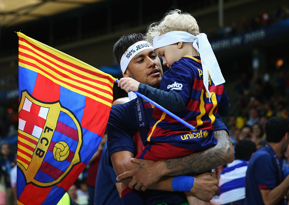 BERLIN, GERMANY - JUNE 06: Neymar of Barcelona celebrates with his son David following the UEFA Champions League Final between Juventus and FC Barcelona at Olympiastadion on June 6, 2015 in Berlin, Germany.  (Photo by Paul Gilham/Getty Images)