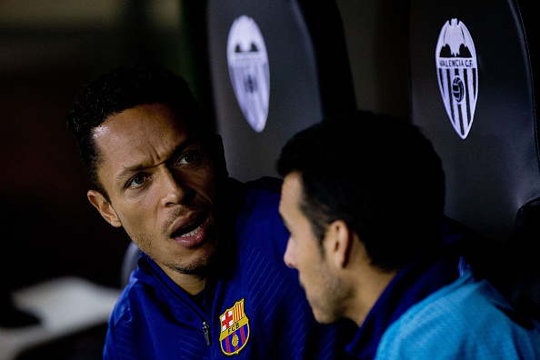 VALENCIA, SPAIN - NOVEMBER 30:  Adriano Correia Claro (L) of FC Barcelona gestures close to his teammate Pedro Rodriguez Ledesma (R) sitted on the bench prior to start the La Liga match between Valencia CF and FC Barcelona at Estadi de Mestalla on November 30, 2014 in Valencia, Spain.  (Photo by Gonzalo Arroyo Moreno/Getty Images)