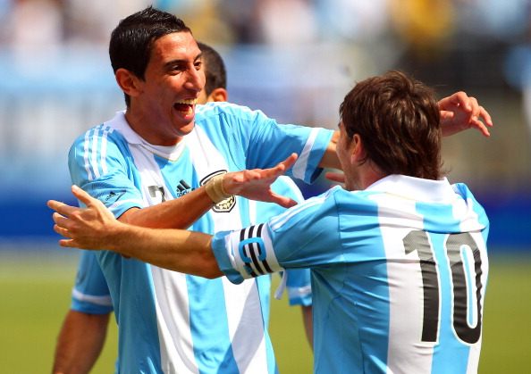 EAST RUTHERFORD, NJ - JUNE 9: Lionel Messi #10 of Argentina is congratulated by teammate Angel di Mar?a #7 after scoring his second goal of the game during the first half of an international friendly soccer match on June 9, 2012 at MetLife Stadium in East Rutherford, New Jersey. Argentina defeated Brazil 4-3 as Messi scored three goals. (Photo by Rich Schultz/Getty Images)