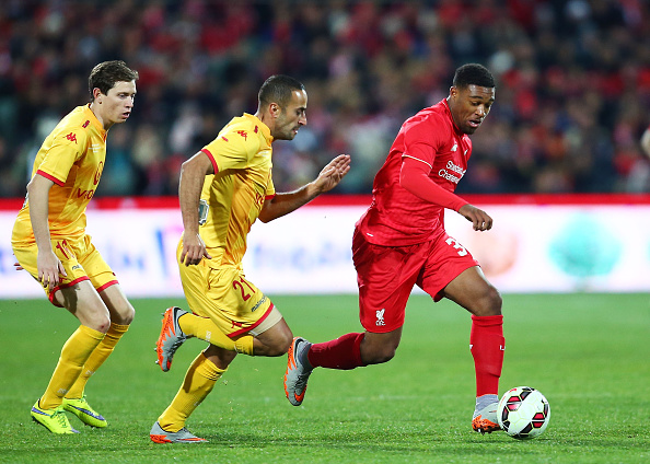 ADELAIDE, AUSTRALIA - JULY 20:  Jordon Ibe of Liverpool is challenged by Tarek Elrich of United during the international friendly match between Adelaide United and Liverpool FC at Adelaide Oval on July 20, 2015 in Adelaide, Australia.  (Photo by Matt King/Getty Images)