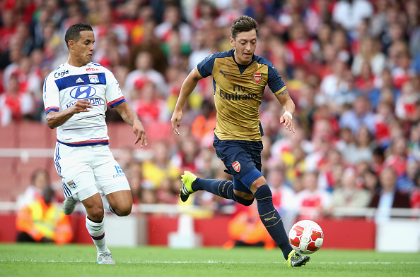 LONDON, ENGLAND - JULY 25:  Mesut Ozil of Arsenal moves away from Mehdi Zeffane during the Emirates Cup match between Arsenal and Olympique Lyonnais at the Emirates Stadium on July 25, 2015 in London, England.  (Photo by David Rogers/Getty Images)