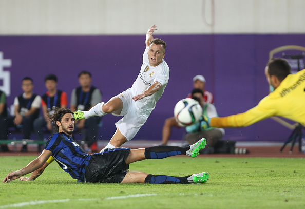 GUANGZHOU, CHINA - JULY 27: Denis Cheryshev of Real Madrid attempts a goal against Ranocchia Andrea of FC Internazionale during the match of International Champions Cup match between Real Madrid and FC Internazionale at Tianhe Stadium on July 27, 2015 in Guangzhou, China. (Photo by Zhong Zhi/Getty Images)