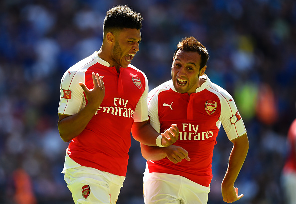 LONDON, ENGLAND - AUGUST 02:  Alex Oxlade-Chamberlain (L) of Arsenal celebrates scoring his team's first goal with his team mates Santi Cazorla (R)  during the FA Community Shield match between Chelsea and Arsenal at Wembley Stadium on August 2, 2015 in London, England.  (Photo by Mike Hewitt/Getty Images)