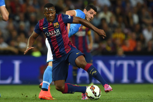 GENEVA, SWITZERLAND - AUGUST 06:  Adama Traore (L) of FC Barcelona is challenged by Blerim Dzemaili of SSC Napoli during the pre-season friendly match between FC Barcelona and SSC Napoli on August 6, 2014 in Geneva, Switzerland.  (Photo by Valerio Pennicino/Getty Images)