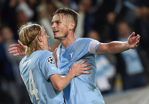 MALMO, SWEDEN - AUGUST 27:  Markus Rosenber of Malmo celebrates after scoring the goal 3-0 during UEFA Champions League qualifying play-offs round second leg match between Malmo FF and Red Bull Salzburg  on August 27, 2014 in Malmo, Sweden.  (Photo by Giuseppe Bellini/Getty Images)