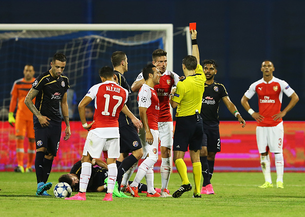 ZAGREB, CROATIA - SEPTEMBER 16:  Olivier Giroud of Arsenal is shown the red card by referee Ovidiu Hategan during the UEFA Champions League Group F match between Dinamo Zagreb and Arsenal at Maksimir Stadium on September 16, 2015 in Zagreb, Croatia.  (Photo by Alexander Hassenstein/Getty Images)