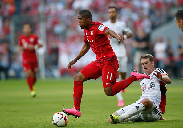 xxx (L) of Muenchen is challenged by yyy of Leverkusen during the Bundesliga match between FC Bayern Muenchen and Bayer 04 Leverkusen at Allianz Arena on August 29, 2015 in Munich, Germany.