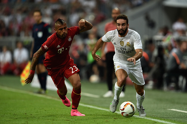 MUNICH, GERMANY - AUGUST 05:  Arturo Vidal of FC Bayern Muenchen and Daniel Carvajal of Real Madrid battle for the ball during the Audi Cup 2015 Final between FC Bayern Muenchen and Real Madrid at Allianz Arena on August 5, 2015 in Munich, Germany.  (Photo by Dennis Grombkowski/Bongarts/Getty Images)