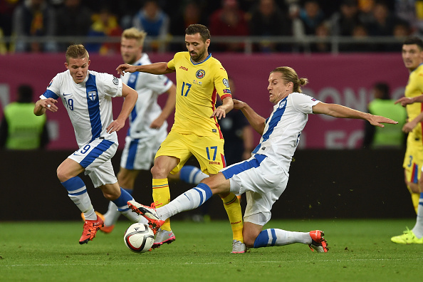 BUCHAREST, ROMANIA - OCTOBER 08:  Lucian Sanmartean (L) of Romania is tackled by Markus Halsti of Finland during the UEFA EURO 2016 Qualifier between Romania and Finland on October 8, 2015 in Bucharest, Romania.  (Photo by Valerio Pennicino/Getty Images)