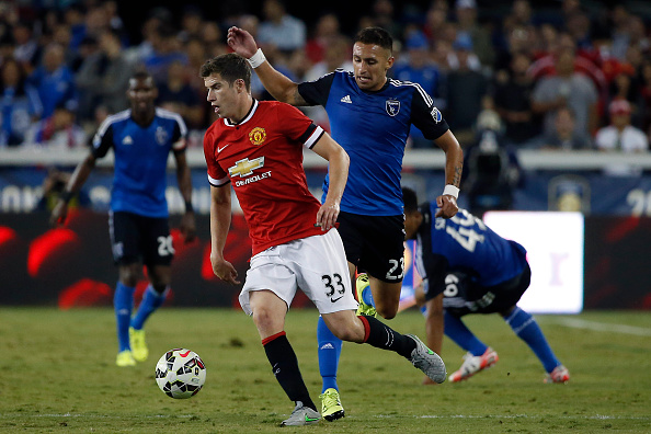 SAN JOSE, CA - JULY 21: Patrick McNair #33 of Manchester United dribbles the ball as Leandro Barrera #23 defends during the second half of their International Champions Cup match on July 21, 2015 at Avaya Stadium in San Jose, California. Manchester United defeated the Earthquakes 3-1. (Photo by Stephen Lam/Getty Images)