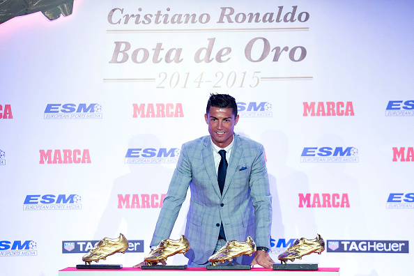 MADRID, SPAIN - OCTOBER 13:  Real Madrid football player Cristiano Ronaldo poses with his four Golden Boot Awards as maximun goal scorer of European leagues at The Westin Palace Hotel on October 13, 2015 in Madrid, Spain.  (Photo by Gonzalo Arroyo Moreno/Getty Images)