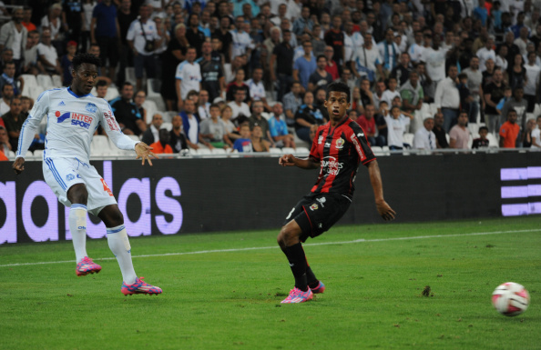 MARSEILLE, FRANCE - AUGUST 29:  Michy Batshuayi (L) of Marseille in action during the French Ligue 1 match between Olympique de Marseille and OGC Nice at Stade Velodrome on August 29, 2014 in Marseille, France.  (Photo by Kaz Photography/Getty Images)