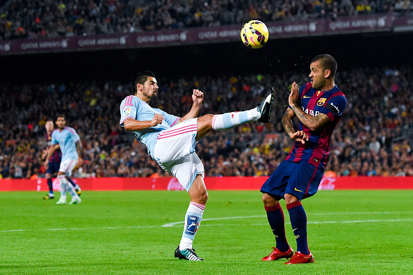 BARCELONA, SPAIN - NOVEMBER 01:  Dani Alves of FC Barcelona competes for the ball with Nolito of Celta de Vigo the La Liga match between FC Barcelona and Celta de Vigo at Camp Nou on November 1, 2014 in Barcelona, Spain.  (Photo by David Ramos/Getty Images)