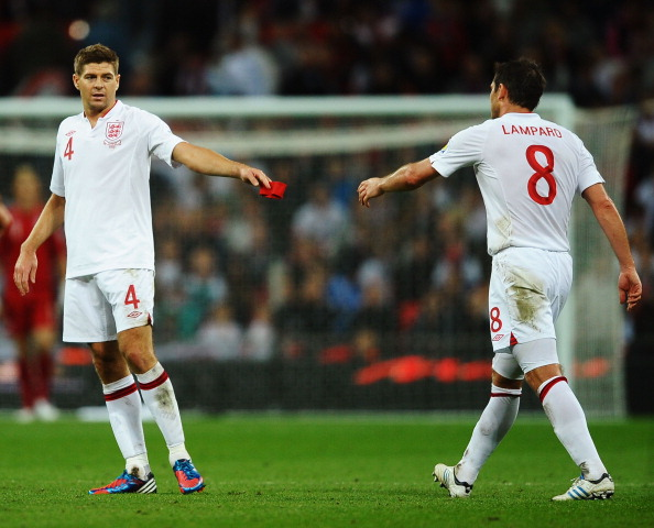LONDON, ENGLAND - SEPTEMBER 11:  Steven Gerrard (L) of England passes the captains armband to Frank Lampard of England after being sent off by match referee Cuneyt Cakir during the FIFA 2014 World Cup Group H qualifying match between England and Ukraine at Wembley Stadium on September 11, 2012 in London, England.  (Photo by Laurence Griffiths/Getty Images)