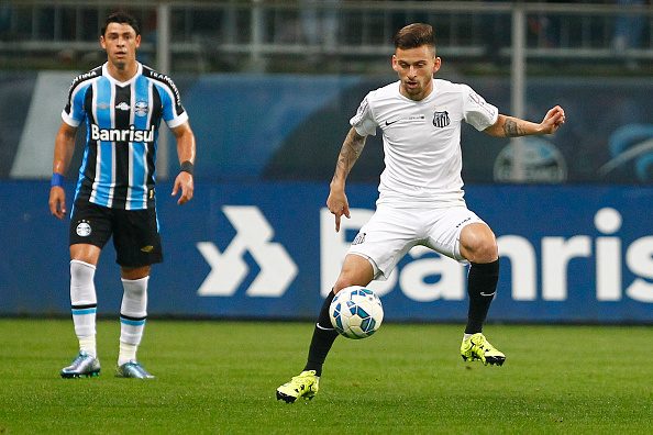 PORTO ALEGRE, BRAZIL - OCTOBER 15: Giuliano of Gremio battles for the ball against Lucas Lima of Santos during the match Gremio v Santos as part of Brasileirao Series A 2015, at Arena do Gremio on October 15, 2015 in Porto Alegre, Brazil. (Photo by Lucas Uebel/Getty Images)