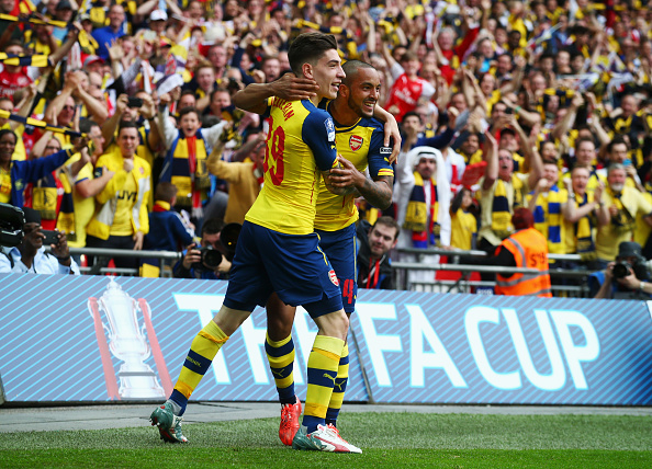 LONDON, ENGLAND - MAY 30:  Theo Walcott of Arsenal (R) celebrates with Hector Bellerin as he scores their first goal during the FA Cup Final between Aston Villa and Arsenal at Wembley Stadium on May 30, 2015 in London, England.  (Photo by Clive Rose/Getty Images)
