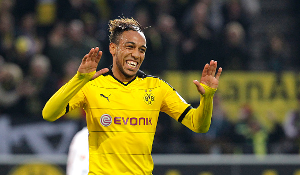 DORTMUND, GERMANY - OCTOBER 25:  Pierre-Emerick Aubameyang of Dortmund celebrates scoring the 4:1 during the Bundesliga match between Borussia Dortmund and FC Augsburg at Signal Iduna Park on October 25, 2015 in Dortmund, Germany.  (Photo by Mika Volkmann/Bongarts/Getty Images)