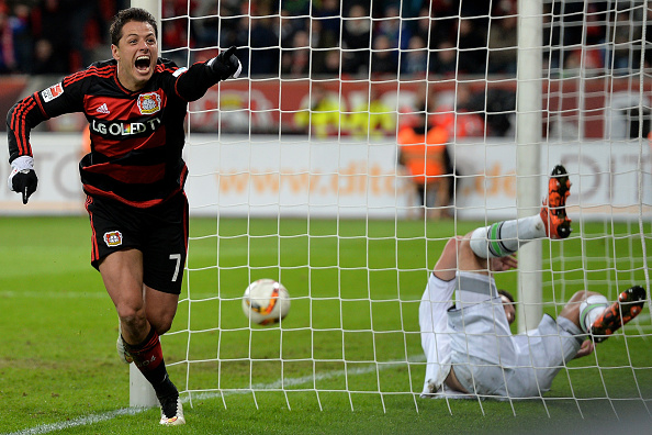 LEVERKUSEN, GERMANY - DECEMBER 12:  Goalkeeper Yann Sommer (R) of Moenchengladbach is beaten by Chicharito (L) of Leverkusen scoring his team's fifth goal during the Bundesliga match between Bayer Leverkusen and Borussia Moenchengladbach at BayArena on December 12, 2015 in Leverkusen, Germany.  (Photo by Sascha Steinbach/Bongarts/Getty Images)