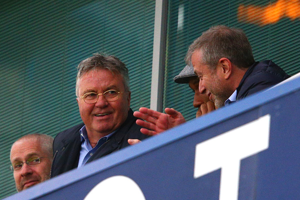 LONDON, ENGLAND - DECEMBER 19:  Chelsea interim manager Guus Hiddink (L), Didier Drogba (C) of Montreal Impact and Chelsea owner Roman Abramovich (R) talk on the stand prior to the Barclays Premier League match between Chelsea and Sunderland at Stamford Bridge on December 19, 2015 in London, England.  (Photo by Clive Mason/Getty Images)