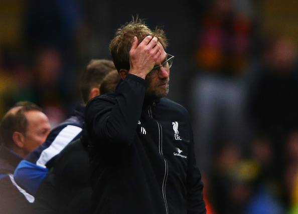 WATFORD, ENGLAND - DECEMBER 20:  Jurgen Klopp manager of Liverpool reacts as Odion Ighalo of Watford scores their third goal during the Barclays Premier League match between Watford and Liverpool at Vicarage Road on December 20, 2015 in Watford, England.  (Photo by Ian Walton/Getty Images)