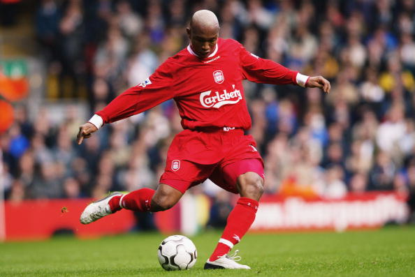LIVERPOOL - OCTOBER 25:  El Hadji Diouf of Liverpool strikes the ball during the FA Barclaycard Premiership match between Liverpool and Leeds on October 25, 2003 at Anfield in Liverpool, England.  Liverpool won the match 3-1.  (Photo by Shaun Botterill/Getty Images)