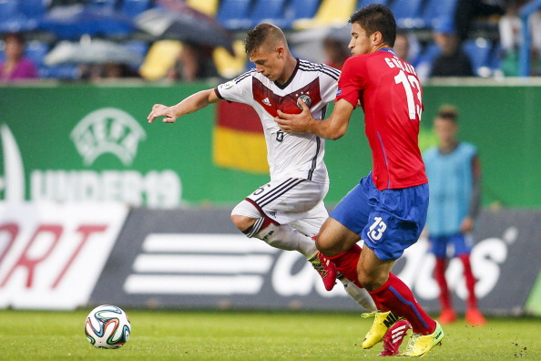 PAPA, HUNGARY - JULY 22: Joshua Kimmich of Germany (L) competes for the ball with Marko Grujic of Serbia during the UEFA Under19 European Championship match between U19 Germany and U19 Serbia at Perutz-Stadium on July 22, 2014 in Papa, Hungary.  (Photo by Christian Hofer/Bongarts/Getty Images)