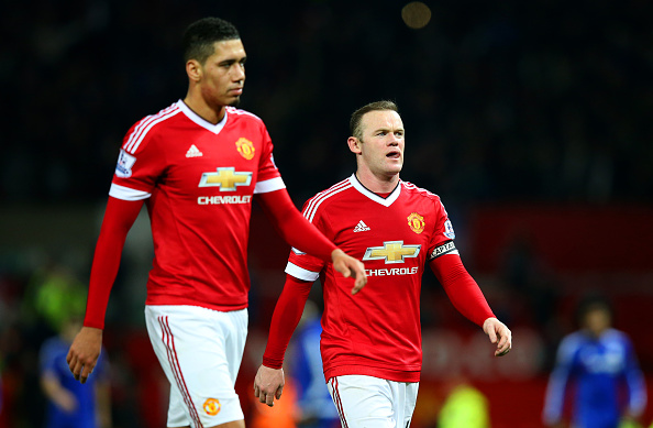 MANCHESTER, ENGLAND - DECEMBER 28:  Wayne Rooney of Manchester United and Chris Smalling of Manchester United react as he leaves the pitch after the Barclays Premier League match between Manchester United and Chelsea at Old Trafford on December 28, 2015 in Manchester, England.  (Photo by Alex Livesey/Getty Images)