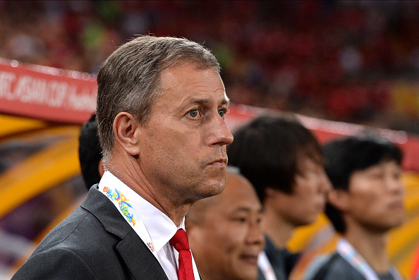 BRISBANE, AUSTRALIA - JANUARY 14: China team Coach Alain Perrin stands for the Chinese national anthem before the 2015 Asian Cup match between China PR and Uzbekistan at Suncorp Stadium on January 14, 2015 in Brisbane, Australia.  (Photo by Bradley Kanaris/Getty Images)