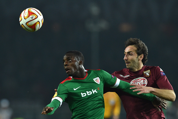 TURIN, ITALY - FEBRUARY 19:  Emiliano Moretti (R) of Torino FC competes with Inaki Williams of Athletic Club during the UEFA Europa League Round of 32 match between Torino FC and Athletic Club on February 19, 2015 in Turin, Italy.  (Photo by Valerio Pennicino/Getty Images)