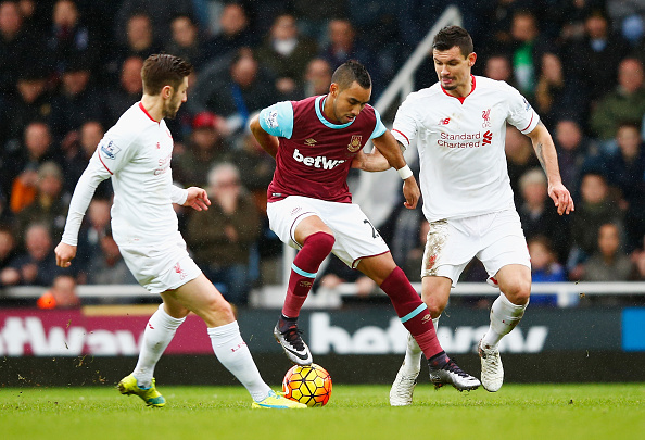 LONDON, ENGLAND - JANUARY 02: Dimitri Payet (C) of West Ham United competes for the ball against Adam Lallana (L) and Dejan Lovren (R) of Liverpool during the Barclays Premier League match between West Ham United and Liverpool at Boleyn Ground on January 2, 2016 in London, England.  (Photo by Christopher Lee/Getty Images)
