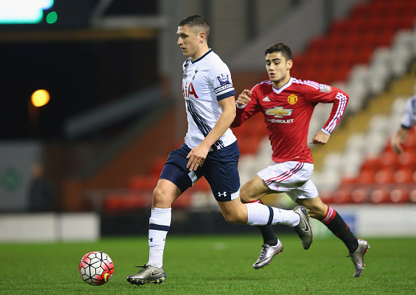 LEIGH, GREATER MANCHESTER - JANUARY 04:  Milos Veljkovic of Tottenham Hotspur U21 brings the ball out ahead of Andreas Pereira of Manchester United U21 during the Barclays U21 Premier League match between Manchester United U21 and Tottenham Hotspur U21 at Leigh Sports Village on January 4, 2016 in Leigh, Greater Manchester.  (Photo by Alex Livesey/Getty Images)