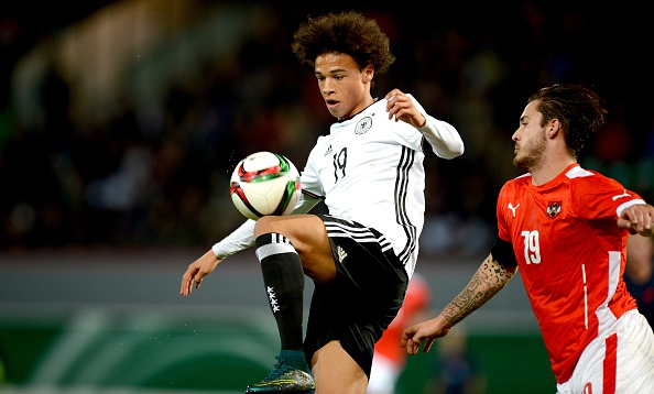 FUERTH, GERMANY - NOVEMBER 17: Leroy Sane (L) of Germany and Christoph Martschinko of Austria compete for the ball during the 2017 UEFA European U21 Championships Qualifier between U21 Germany and U21 Austria at Stadion am Laubenweg on November 17, 2015 in Fuerth, Germany.  (Photo by Micha Will/Bongarts/Getty Images)