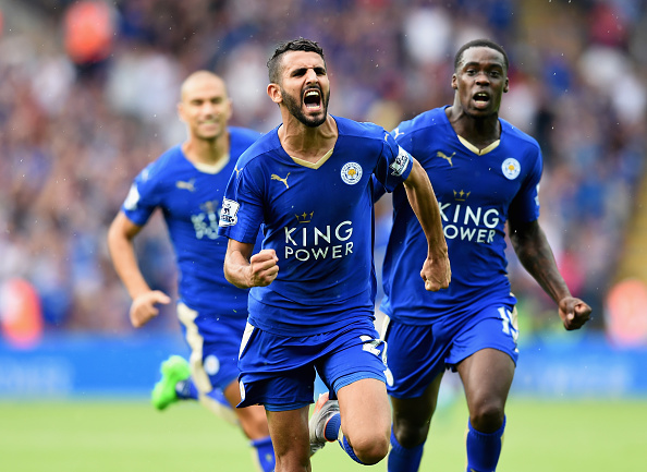 LEICESTER, ENGLAND - AUGUST 22:  Riyad Mahrez of Leicester City celebrates scoring his team's first goal  during the Barclays Premier League match between Leicester City and Tottenham Hotspur at The King Power Stadium on August 22, 2015 in Leicester, England.  (Photo by Michael Regan/Getty Images)