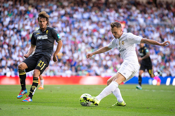 MADRID, SPAIN - SEPTEMBER 19:  Denis Cheryshev (R) of Real Madrid CF competes for the ball with Rene Krhin (L) of Granada CF during the La Liga match between Real Madrid CF and Granada CF at Estadio Santiago Bernabeu on September 19, 2015 in Madrid, Spain.  (Photo by Gonzalo Arroyo Moreno/Getty Images)