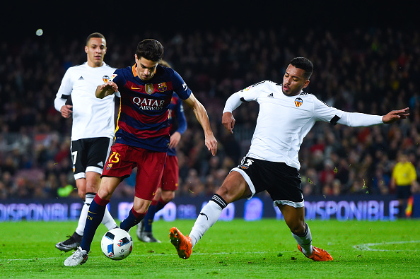 BARCELONA, SPAIN - FEBRUARY 03:  Marc Bartra of FC Barcelona competes for the ball with Ruben Vezo of Valencia CF during the Copa del Rey Semi Final first leg match between FC Barcelona and Valencia at Nou Camp on February 3, 2016 in Barcelona, Spain.  (Photo by David Ramos/Getty Images)