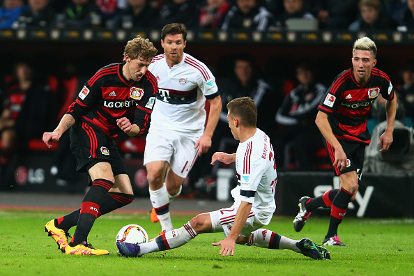 LEVERKUSEN, GERMANY - FEBRUARY 06: Stefan Kiessling (L) of Leverkusen is challenged by Joshua Kimmich of Muenchen during the Bundesliga match between Bayer Leverkusen and FC Bayern Muenchen at BayArena on February 6, 2016 in Leverkusen, Germany.  (Photo by Alex Grimm/Bongarts/Getty Images)