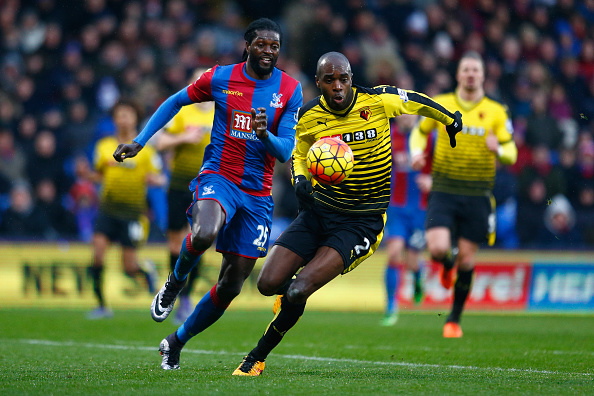LONDON, ENGLAND - FEBRUARY 13:  Allan-Romeo Nyom of Watford and Emmanuel Adebayor of Crystal Palace compete for the ball during the Barclays Premier League match between Crystal Palace and Watford at Selhurst Park on February 13, 2016 in London, England.  (Photo by Julian Finney/Getty Images)