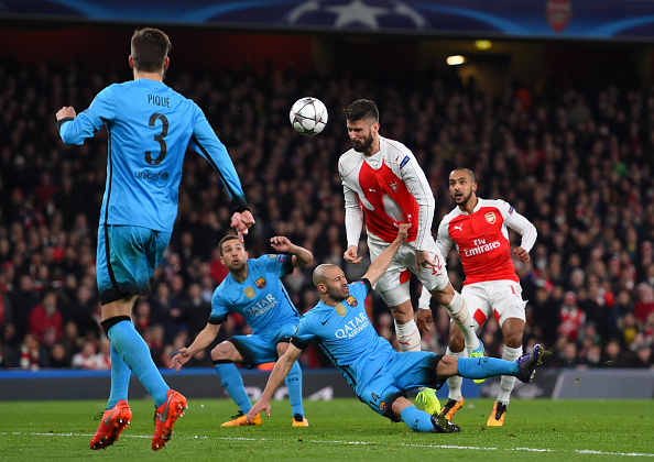 LONDON, ENGLAND - FEBRUARY 23:  Olivier Giroud of Arsenal directs a header on goal despite the attentions of Javier Mascherano of Barcelona during the UEFA Champions League round of 16, first leg match between Arsenal FC and FC Barcelona at the Emirates Stadium on February 23, 2016 in London, United Kingdom.  (Photo by Shaun Botterill/Getty Images)