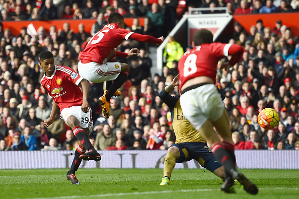 MANCHESTER, ENGLAND - FEBRUARY 28:  Marcus Rashford of Manchester United scores his opening goal during the Barclays Premier League match between Manchester United and Arsenal at Old Trafford on February 28, 2016 in Manchester, England.  (Photo by Laurence Griffiths/Getty Images)