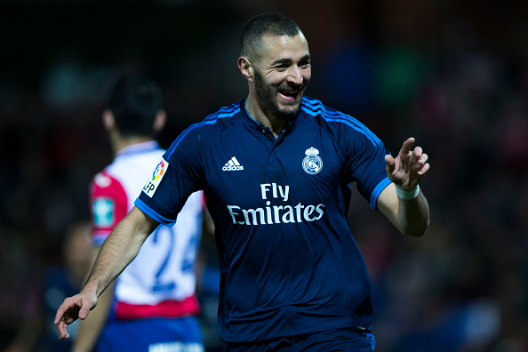 GRANADA, SPAIN - FEBRUARY 07:  Karim Benzema of Real Madrid CF celebrates scoring their opening goal during the La Liga match between Granada CF and Real Madrid CF at Estadio Nuevo Los Carmenes on February 7, 2016 in Granada, Spain.  (Photo by Gonzalo Arroyo Moreno/Getty Images)