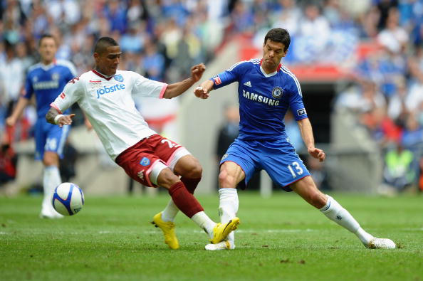 LONDON, ENGLAND - MAY 15:  Michael Ballack of Chelsea is tackled and fouled by Kevin Prince Boateng of Portsmouth during the FA Cup sponsored by E.ON Final match between Chelsea and Portsmouth at Wembley Stadium on May 15, 2010 in London, England.  (Photo by Laurence Griffiths/Getty Images)