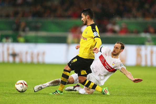 STUTTGART, GERMANY - FEBRUARY 09:  Georg Niedermeier of Stuttgart tackles Ilkay Gundogan of Borussia Dortmund during the DFB Cup Quarter Final match between VfB Stuttgart and Borussia Dortmund at Mercedes-Benz Arena on February 9, 2016 in Stuttgart, Germany.  (Photo by Alex Grimm/Bongarts/Getty Images)