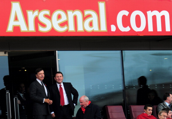 LONDON, ENGLAND - OCTOBER 27:  Arsenal owner Stan Kroenke (L) looks on prior to kickoff during the Barclays Premier League match between Arsenal and QPR at The Emirates Stadium on October 27, 2012 in London, England.  (Photo by Shaun Botterill/Getty Images)