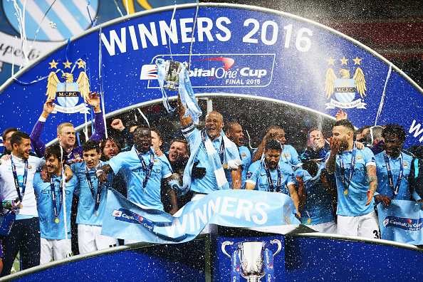 LONDON, ENGLAND - FEBRUARY 28:  Vincent Kompany of Manchester City and team mates celebrate victory with the trophy after the Capital One Cup Final match between Liverpool and Manchester City at Wembley Stadium on February 28, 2016 in London, England. Manchester City win 3-1 on penalties.  (Photo by Michael Steele/Getty Images)