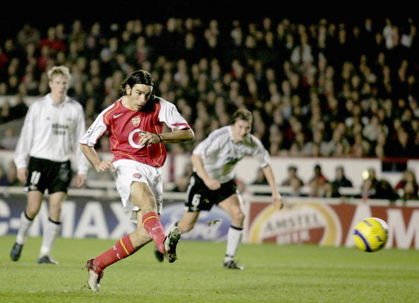LONDON - DECEMBER 7:  Robert Pires of Arsenal scores a penalty during the Champions League Group E match between Arsenal and Rosenborg at Highbury on December 7, 2004 in London, England.  (Photo by Shaun Botterill/Getty Images)