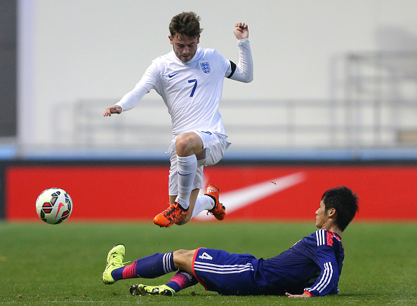 MANCHESTER, ENGLAND - NOVEMBER 15: Patrick Roberts of England is tackled by Reiya Morishita of Japan during the U19 International friendly match between England and Japan at Manchester City Academy Stadium on November 15, 2015 in Manchester, England. (Photo by Dave Thompson/Getty Images)