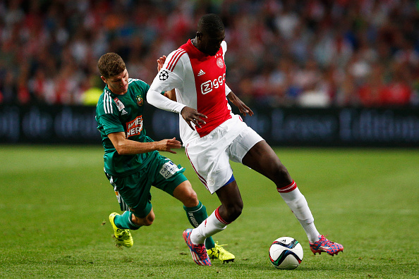 AMSTERDAM, NETHERLANDS - AUGUST 04:  Yaya Sanogo of Ajax battles for the ball with Stephan Auer of Rapid Wien during the third qualifying round 2nd leg UEFA Champions League match between Ajax Amsterdam and SK Rapid Vienna held at Amsterdam ArenA on August 4, 2015 in Amsterdam, Netherlands.  (Photo by Dean Mouhtaropoulos/Getty Images)